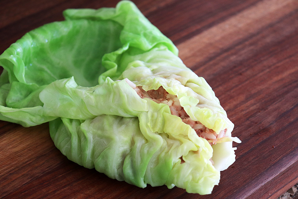 Fold in the sides of the cabbage leaves