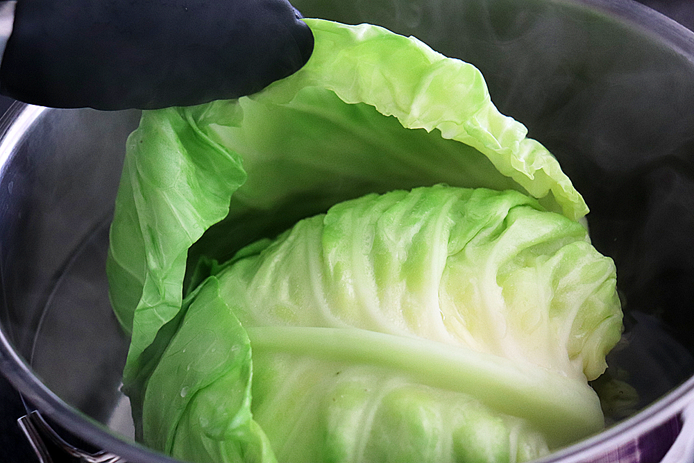 Peeling away the cabbage leaves by blanching in boiling water