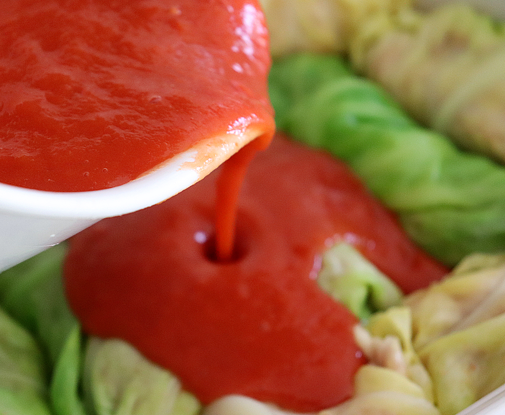Saucing the stuffed cabbage rolls