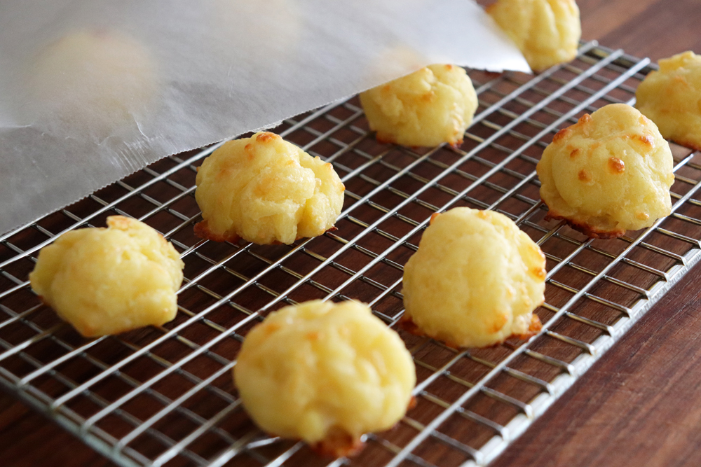 The baked puffs on a cooling rack - store lightly covered with waxed paper