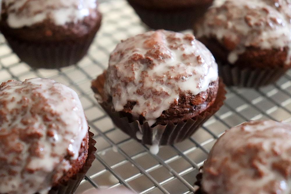 Close up of Glazed Chocolate Doughnut Muffins